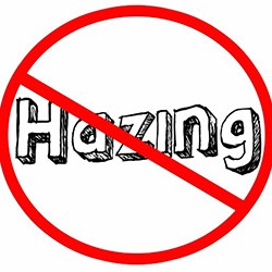 The word hazing with a line through it